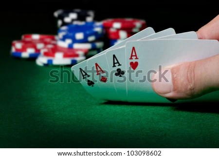 Stack of chips and four aces - stock photo