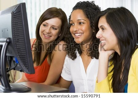stock photo : Female college students in a computer lab