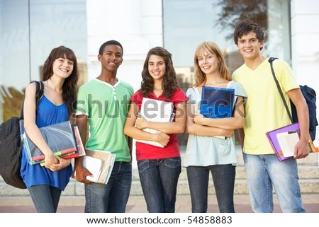 stock photo : Group Of Teenage Students Standing Outside College Building