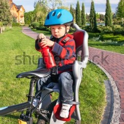The Bike Chair Gold Sequin Covers Free Bicycle Seat 23899 Stock Photo Avopix Com Protection On Baby Boy Is In With