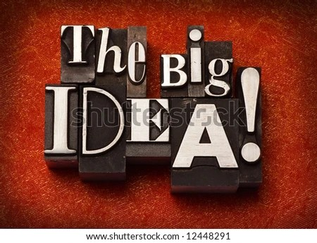 """stock photo : The phrase """"The Big Idea!"""" done in old letterpress type on a red fabric background."""