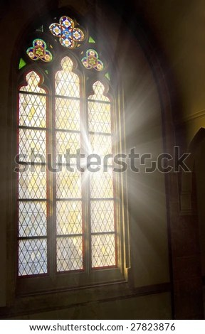 stock photo : Church stained-glass window with sunlight shining through