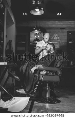 ez chair barber tanning chairs walmart serious bearded man getting haircut by while sitting in at barbershop theme