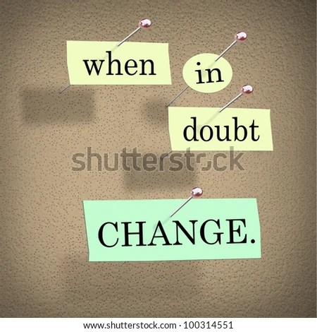 stock photo : The words When in Doubt Change pinned to a cork bulletin board representing self-help improvement advice to motivate you to make positive changes in your life for success