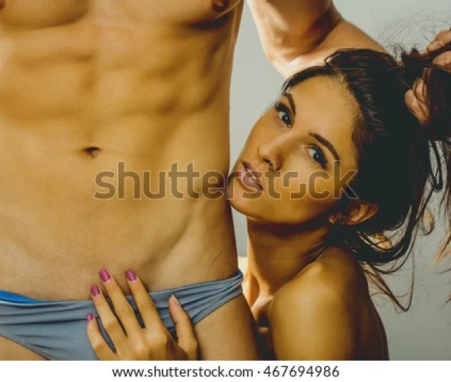 Young Sexy Couple Of Muscular Man With Bare Chest And Torso With Six Packs Embrace Naked