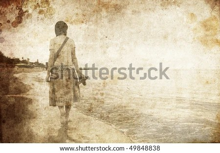 Girl at sea. Photo in old image style. - stock photo