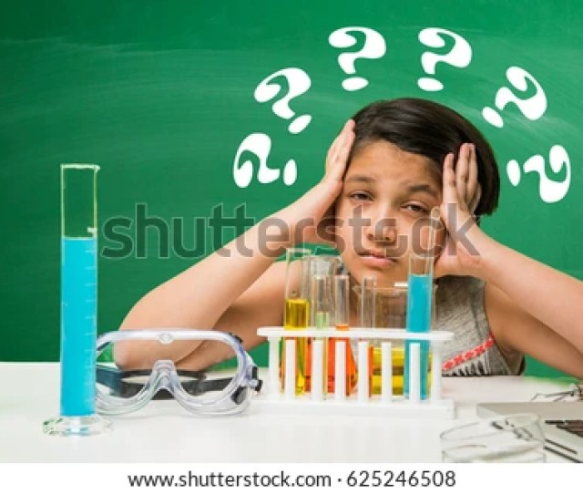Cute Little Indian Asian School Girl Experimenting Or Studying Science In Laboratory Over Green