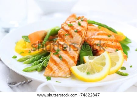 stock photo : grilled salmon with asparagus, pea, yellow peppers, carrots and spring onions on white plate