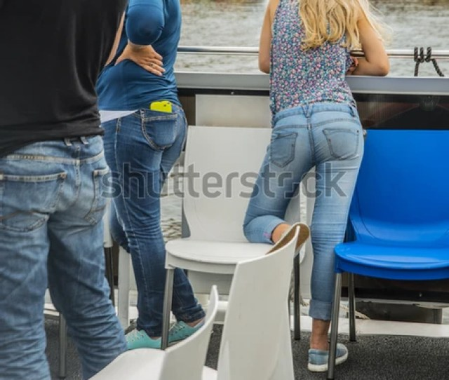 Family Standing On Yacht Or Boat Rear View Sexy Ass In Blue Denim Jeans