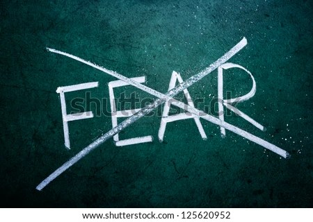 No fear concept, word on grungy blackboard - stock photo