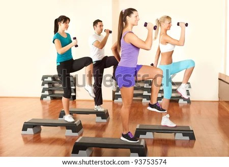 stock photo : Group of people at the gym exercising with free weights