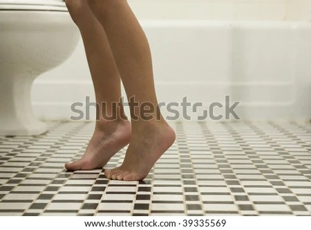 Child's Feet and Legs in Bathroom