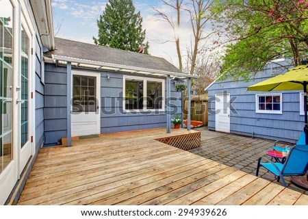 perfect back deck with concrete patio umbrella and chairs stock images page everypixel