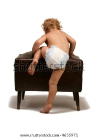 A Baby Girl Learning To Sit Up On A High Long Chair Stock ...