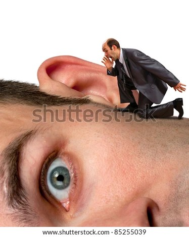 Small businessman screaming to big man ear - stock photo