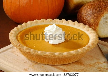 A fresh pumpkin pie, a Thanksgiving or holiday treat - stock photo