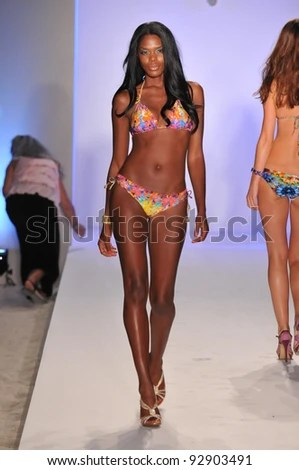 https://i0.wp.com/image.shutterstock.com/display_pic_with_logo/55912/55912,1326755024,3/stock-photo-miami-july-model-walking-runway-at-the-luli-fama-collection-for-spring-summer-during-92903491.jpg