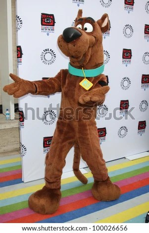 """LOS ANGELES - APR 12:  Scooby-Doo arrives at Warner Brothers """"Television: Out of the Box"""" Exhibit Launch at Paley Center for Media on April 12, 2012 in Beverly Hills, CA - stock photo"""