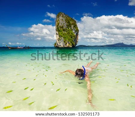 Woman swimming with snorkel, Andaman Sea, Thailand - stock photo