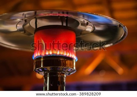 design stainless steel metal gas burning indoor patio heater with blurred enteriour background stock images page everypixel