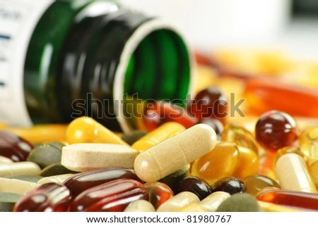 stock photo : Composition with nutritional supplement capsules and containers. Variety of drug pills