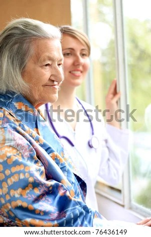 Doctor and her patient smiling - stock photo