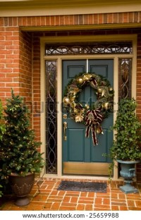 A Festively Decorated Front Door At Christmas Stock Photo ...