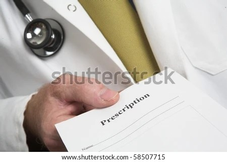stock photo : Doctors hand holding prescription