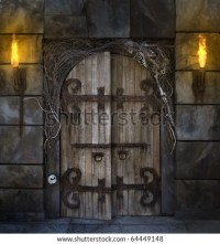 Spooky Dungeon Door Flanked With Two Flaming Torches And ...