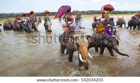 SURIN, THAILAND - MAY 16: Traditional parade to the river as an audience watching the annual Surin Elephant on May 16, 2011 in Surin, Thailand. - stock photo