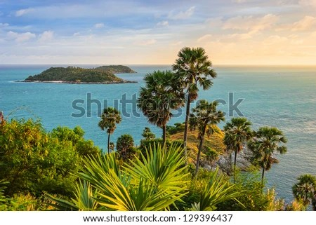 Cape is a mountain of rock that extends into the sea in Phuket, Thailand - stock photo