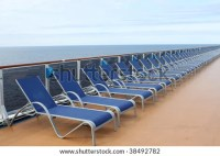 Long Row Of Beach Chair Loungers On The Deck Of A Ship ...