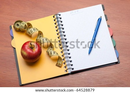 stock photo : Planning of a diet. A notebook c an inscription - the Diet, a measuring tape, an apple and pen