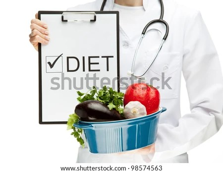 "stock photo : Doctor prescribing healthy natural food; closeup of doctor's hands holding clipboard with marked checkbox ""Fresh vegetables"" and brazier with vegetables; healthy eating concept isolated on white"