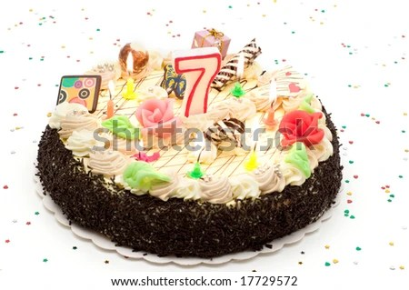 stock photo : Birthday cake 7 years with candles and glitter