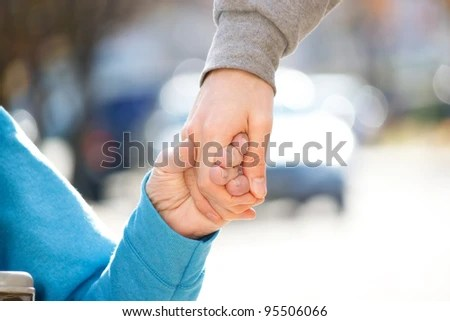 stock photo : Young Caregiver Holding Senior's Hand Outside