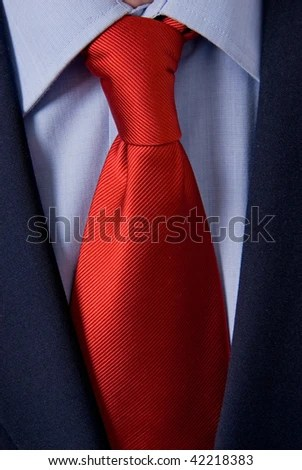 Bright Red Tie On White Shirt And Black Suit Stock Photo