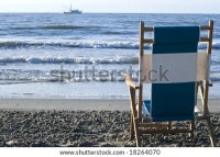 View Of The Surf From Behind A Single Beach Chair With A ...