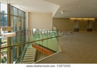 Balcony Overlooking Modern Glass Lobby In Office Building ...