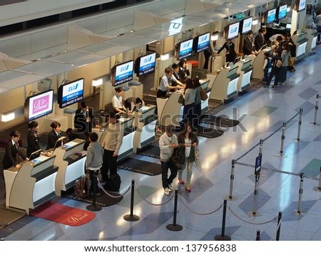 Tokyo -May 3: Check In Counter At Tokyo International Airport,怎麼用漢語翻譯check in counter, 2013. Tokyo International Airport Is One Of The Two Primary ...