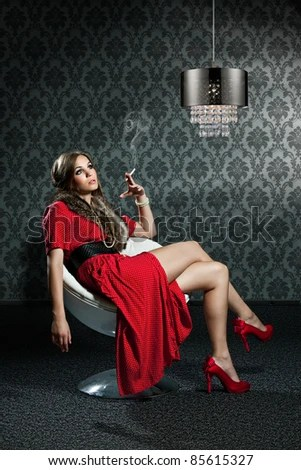 Beautiful Simple Girl Wallpaper Woman With Cigarette And Red Dress Is Sitting In Front Of