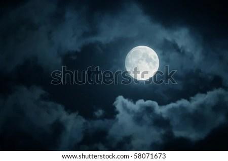 full moon over dark sky with. - stock photo