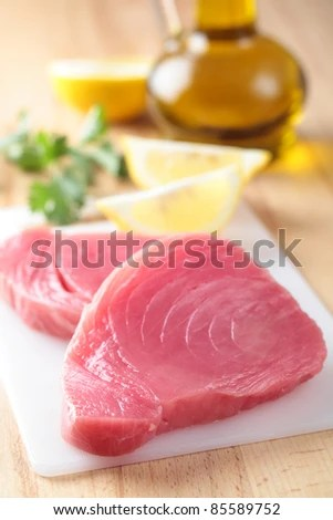 stock photo : Raw tuna steaks on a cutting board