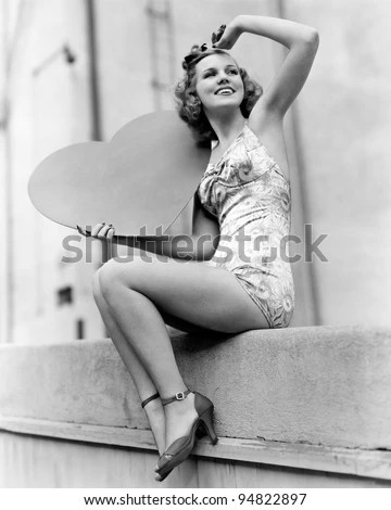 Woman holding a large valentine - stock photo