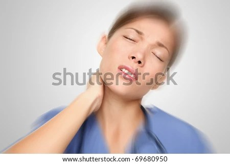 stock photo : Nurse or young woman doctor having neck and back pain problems at work. Mixed-race Asian / Caucasian female model.