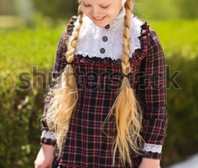Attractive Blonde Schoolgirl With Long Hair