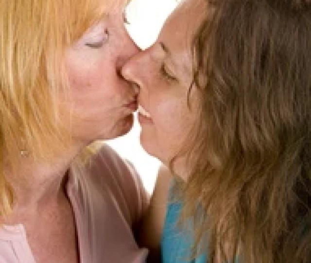 Attractive Mature Lesbian Couple Kissing Isolated On White