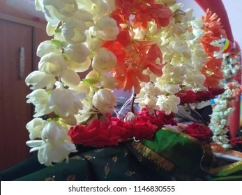 Baby Cradle Decoration Done By Using Fireer Jasmine And Rose Garland During Naming Ceremony Of