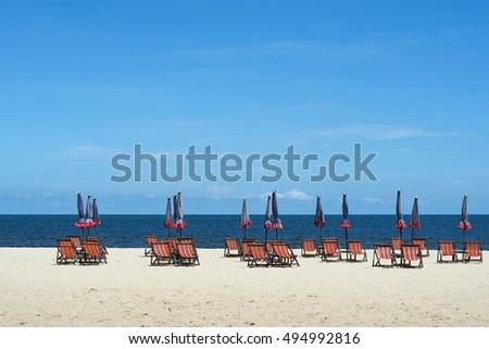 infant beach chair with umbrella stacking dining chairs john lewis bench seat stock photo edit now 494992816 or on the white sand