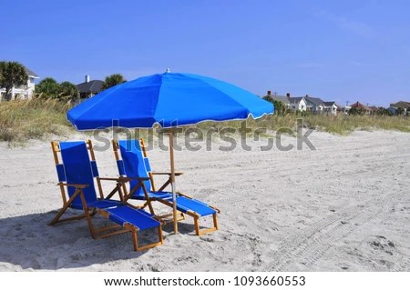 beach chairs with umbrellas light blue chair covers offer welcoming shade stock photo edit now and on a hot summer day at the seashore